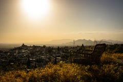 Take your locality. A chair at a lookout. Sit down and relax. Do nothing for awhile, just breathe and see the how the Sun goes down Stock Photos