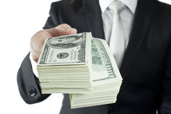 Take your money. A well-dressed man gives money Stock Photography