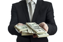 Take your money. A well-dressed man gives money royalty free stock image