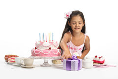 Take your present. Little Asian beautiful girl celebrate her seventh birthday stock photography