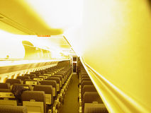 Take your seat. The inside of a passenger aircraft royalty free stock photo