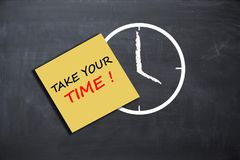 Take your time concept with alarm clock on school board. Take your time concept with alarm clock on blackboard Stock Photos