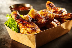 Takeaway box of crispy grilled chicken legs Royalty Free Stock Images