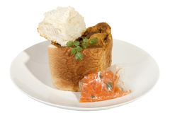 Takeaway Bunny Chow Served with Carrot Sambal and Dhunia Stock Photo