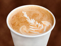 Takeaway Cappuccino. Closeup of cappuccino in a takeaway cup royalty free stock photo