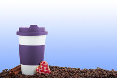 Takeaway ceramic cup and coffee beans on blue background Royalty Free Stock Photography
