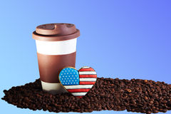 Takeaway ceramic cup and coffee beans on blue background. Close view at at take away brown ceramic cup gingerbread heart shaped cookies with american flag Royalty Free Stock Photo