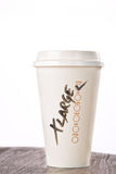 Takeaway coffee cup with 'XLarge' written on it Royalty Free Stock Photo