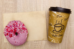 Takeaway coffee and donut Stock Photography
