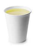 Takeaway cup with green or herbal tea isolated on white Royalty Free Stock Photos