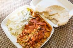 Take away food, Turkish or Greek gyros plate on take away box Stock Photo