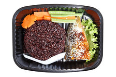 Takeaway food. Streamed riceberry rice with grilled mackerel Saba Shioyaki and vegetables Royalty Free Stock Photography