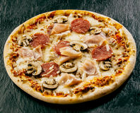 Takeaway Italian pizza with salami and ham Royalty Free Stock Image