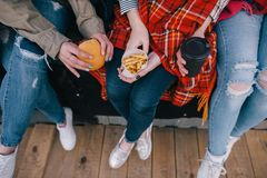 Takeaway junk food in meeting close friends Stock Photography