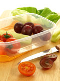 Takeaway light meal. Preparation on takeaway light dietary meal: vegetables and fruits Royalty Free Stock Photography