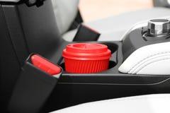 Takeaway paper coffee cup in holder car. Takeaway paper coffee cup in holder inside car stock image