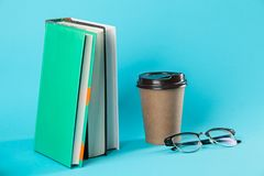 Takeaway paper coffee cup mockup isolated on blue background. royalty free stock photography