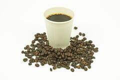 Takeaway paper cup of coffee and coffee bean isolated on white b. Ackground Stock Photography
