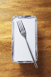 Takeaway tray and fork Stock Photo