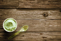 Takeaway tub of creamy green Italian ice cream Royalty Free Stock Photo