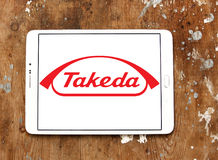 Takeda Pharmaceutical Company logo. Logo of Takeda Pharmaceutical Company on samsung tablet on wooden background . Takeda is the largest pharmaceutical company Royalty Free Stock Photo