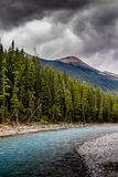 Taken from along the Ice Fields Parkwayl Banff National Park, Alberta, Canada. Dark clouds roll in over the mountains while a river meanders by Stock Photography