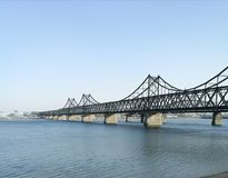 China - North Korea Friendship bridge; across the Yalu river. Taken in April, 2017, from public area in Dandong, Liaoning China, opposite to Sinuiju city, DPRK Stock Images
