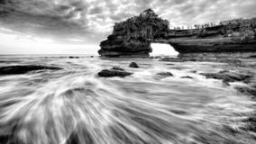Huge beautiful cliff, arches and caves in Bali, Indonesia. This is taken in Bali, Indonesia. It was taking during sunset. There are huge beautiful cliff, arches stock photos
