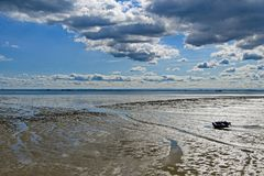 Abandoned boat on South End on Sea mud flats. royalty free stock image