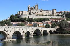 Beziers Cathedral France. Taken in Beziers, in southern France in the Languedoc region. Shows The Saint Nazaire Ancient Cathedral. The river L`orb runs along the Stock Photography