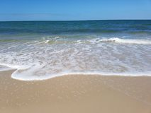 Beach Froth ocean on bribie island Royalty Free Stock Photos