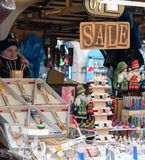 A female sells souvenirs and other trinkets to tourists from a stall in the middle of Prague stock image