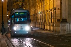 PRAGUE, CZECH - 12TH APRIL 2019: A tram in Prague travels through the night with a female driver at the front stock photography