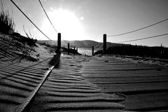 The lonely walkway - Monterrey CA. Taken in February of 2017, in Monterrey CA. it was super windy that day, so no one was outside. Plus, the wind created these Royalty Free Stock Images