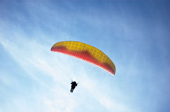 Paragliding against a rich blue sky Stock Image