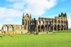 View of Whitby Abbey from inside the visiter centre grounds. Taken in the middle of a very sunny day in late winter, to show the full width of Whitby Abbey from Royalty Free Stock Photography