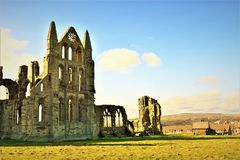 View of Whitby Abbey from the front, inside the visiter centre grounds. Taken in the middle of a very sunny day in late winter, to show an inland view of Whitby Stock Photo