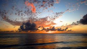 Clouds and sunset in barbados beach royalty free stock photo
