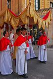 Religious festival celebration in Gozo, Malta with solemn men holding poles supporting fabric to cover probably the pastor