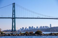Lions Gate Bridge frames view of Vancouver with Stanley Park royalty free stock photos