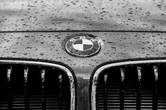 Monochrome image of a luxury, german-made sports car showing details of its badge and grille area. royalty free stock photo