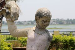 Sculpture of Son Holding Hands of Mother. Taken of A Son holding his mother hand and smiling showing the tribal culture Stock Images