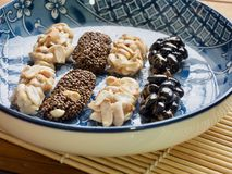 Korean traditional snacks Sweet Rice Puffs , Black sesame gangjeong, Peanut gangjeong stock photo