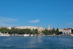 View of the Amphitheatre from Pula harbour, Croatia. stock images