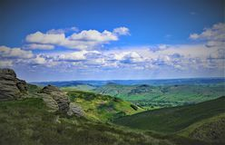 View of Hope valley, in the Derbyshire peaks. Taken on a sunny summer`s day, this image shows a distant view of Hope valley underneath a blue sky Stock Photography