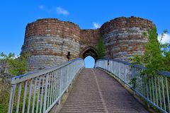 Walkway and bridged entrance into Beeston Castle, off the Sandstone trail, POV 4, Cheshire. Taken to capture all the colours of late spring, along the Sandstone stock photo