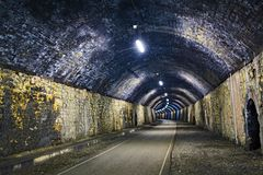 Blue and yellow glow inside the Litton Tunnel, on the Monsal Trail,` Peak District, Derbyshire. royalty free stock photo