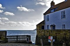 North Sea view, in Robin Hood`s Bay, Old Town, North Yorkshire. stock image