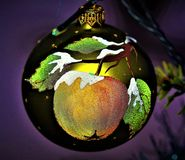 Apple of my eyes: Bauble with rare purple bokeh stock photography