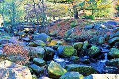 Bridge and stream, in Padley Gorge, Grindleford, East Midlands. stock photography